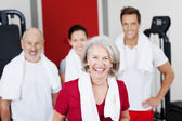 Happy Senior Woman With Family At Gym — Stock Photo