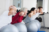 Happy Family Exercising On Swiss Ball — Stock Photo