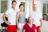 Family Smiling Together In Gym — Stock Photo