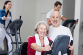 Happy Senior Couple With Using Treadmill In Background At Gym — Stock Photo