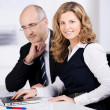 Friendly businesswoman working with a colleague — Stock Photo