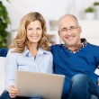 Couple Using Laptop And Credit Card For Online Shopping — Foto Stock