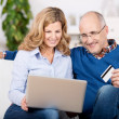 Married couple ordering on the internet — Stock Photo