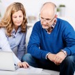 Married couple working on paperwork at home — Stock Photo