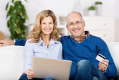 Couple Using Laptop And Credit Card For Online Shopping — Stock Photo