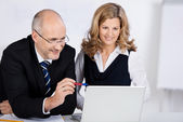 Businesspeople Looking At Laptop In Office — Stock Photo