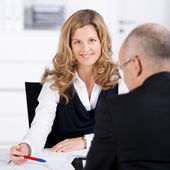 Businesswoman Conversing With Businessman At Desk — Stock Photo