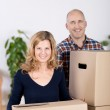 Couple Carrying Cardboard Boxes At New Home — Stock Photo