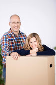 Couple taking a break from packing up the house — Stock Photo