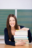 Smiling student with her books — Stock Photo