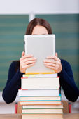 Woman with books and ipad touch — Stock Photo