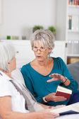 Two senior women having a conversation — Stock Photo