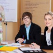 Stock Photo: Young trainees in business school