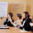 Business class applauding the female lecturer — Stock Photo