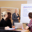 Business coach at flipchart — Stock Photo