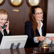 Two receptionists at a reception desk — Stock Photo #29706911