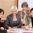 Foto Stock: Four women working together
