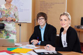 Young trainees in business school — Stock Photo