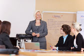 Smiling businesswoman giving a presentation — Stock Photo