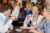 Three friends having coffee together — Stock Photo
