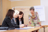 Senior businesswoman in a meeting — Stock Photo