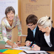 Stock Photo: Manager supervising work of employees