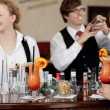 Mixing cocktails at the bar — Stock Photo