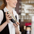 Barmaid shaking a cocktail shaker — Stock Photo #29729381