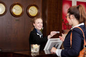Guest at a hotel requesting a card — Stock Photo