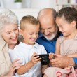 Grandchildren with their grandparents — Stock Photo