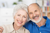 Affectionate happy retired couple — Stock Photo