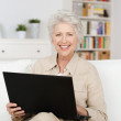 Senior woman working an a laptop — Stock Photo #30761165