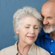 Elderly couple share a tender moment — Stock Photo