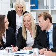 Stock Photo: Dedicated business team having a discussion