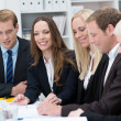 Стоковое фото: Smiling young woman in a business meeting