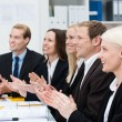 Stock Photo: Smiling business people clapping their hands