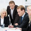 Stock Photo: Business team brainstorming