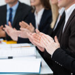 Businesspeople in a meeting applauding — Stock Photo #31019291