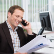 Stock Photo: Efficient businessmanswering phone call