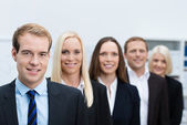 Serious young business manager with his team — Stock Photo