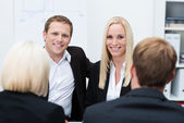 Smiling coworkers in a business meeting — Stock Photo