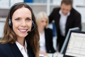 Friendly attractive young call centre operator — Stock Photo