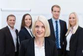 Blond Caucasian female young manager smiling — Stock Photo