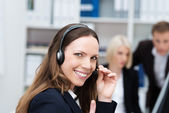 Happy call centre operator — Stock Photo