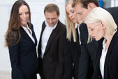 Attractive blond businesswoman with her team — Stock Photo