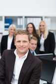 Smiling succesful business team leader — Stock Photo