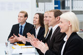 Smiling business people clapping their hands — Stock Photo