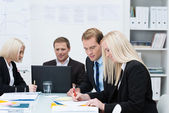 Business men and women in a meeting — Stock Photo