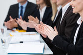 Businesspeople in a meeting applauding — Stock Photo