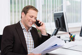 Efficient businessman answering a phone call — Stock Photo